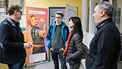 Felix Stecher (left), Head of Vocational Training at the Zumtobel Group, talking to visitors.