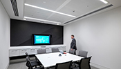 With intelligent sensors the lighting system in the third room reacts to the way the meeting room is being used, and adapts e.g. to discussion or presentation scenarios.